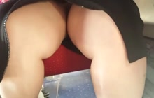 Upskirt under table in train